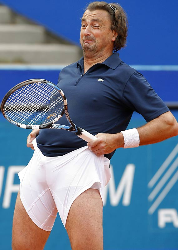 Former French tennis ace Henri Leconte can't get comfortable during his match with Michael Stich at the ATP BMW Open tennis tournament.