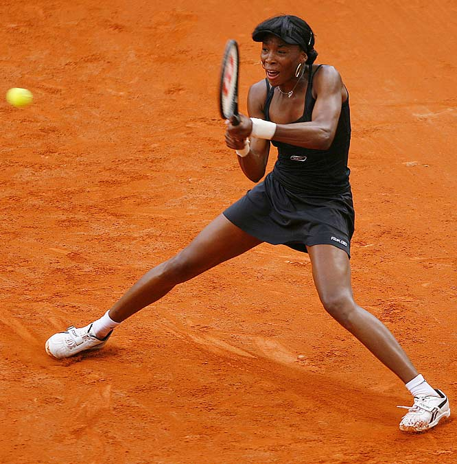 Venus Williams fought off bad weather and France's Alize Cornet to win 6-4, 6-3 on Monday.