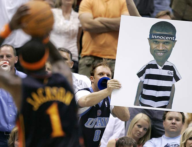 A Jazz fan holds up a sign to distract Warriors guard Stephen Jackson. The real crime here is the cow lick in that fan's hair. We know you feel us, blondie.