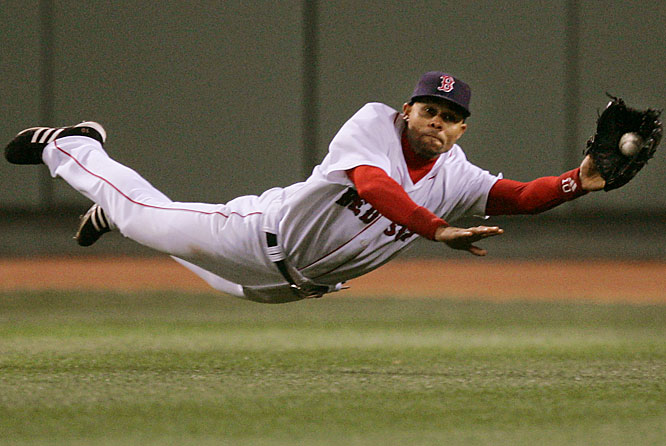 Red Sox centerfielder Coco Crisp makes a diving catch on a line drive off the bat of the A's Jason Kendall for the second out of the ninth inning on May 2.  The Red Sox held on to win 6-4.