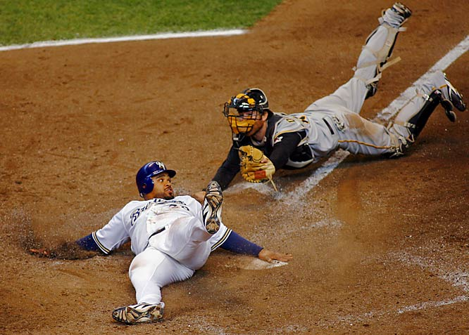 Prince Fielder beats the tag by Pirates catcher Ryan Doumit to score the go-ahead run for the Brewers in the eighth inning.  Fielder went 3-for-4 with 2 home runs and 3 RBIs in the Brewers' 6-4 victory on Sunday.