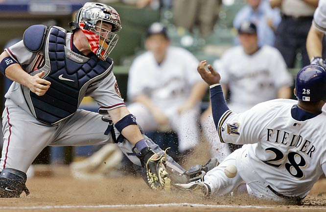 Prince Fielder slides past Nationals catcher Brian Schneider to give the Brewers the lead on May 9.  Milwaukee won 3-1.