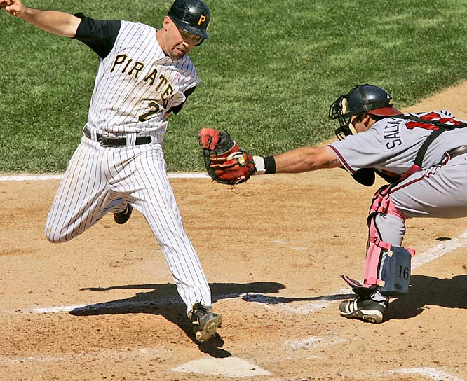 Jack Wilson narrowly avoids the tag of Atlanta's Jarrod Saltalamacchia during Pittsburgh's 13-2 win on Sunday.