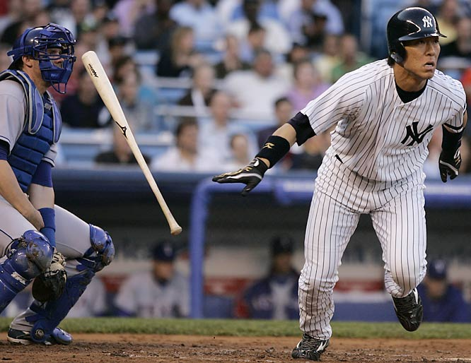 It wasn't as close as it looks... Texas catcher Chris Stewart was unharmed as Hideki Matsui left his bat behind and broke for first after hitting a RBI double in the Yankees 6-2 win on May 9.