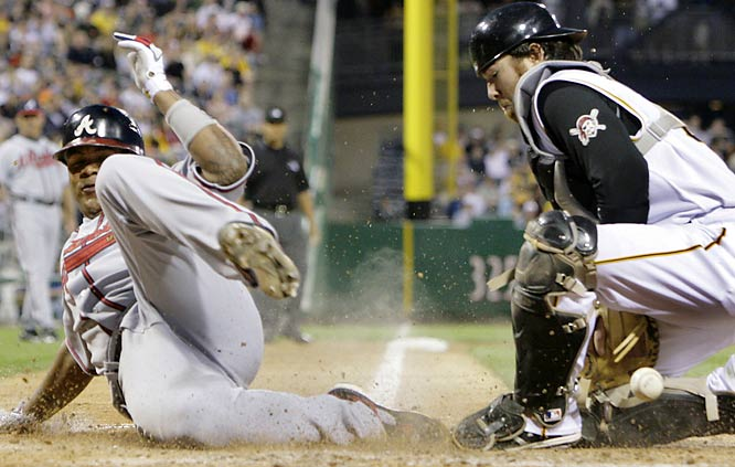 Pittsburgh's Ryan Doumit can't handle the throw from third, allowing the Braves' Andruw Jones to score Saturday.  Atlanta won 9-2.