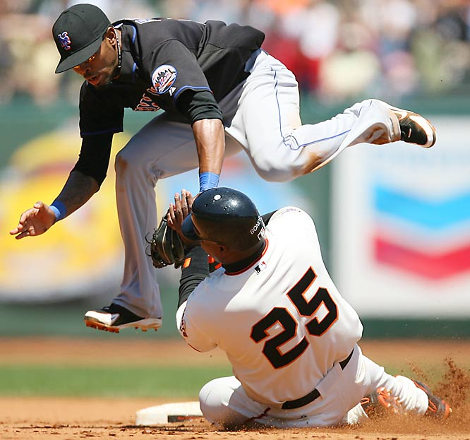 Barry Bonds is forced out by Mets shortstop Jose Reyes in the fourth inning on May 9. The Mets won 5-3.