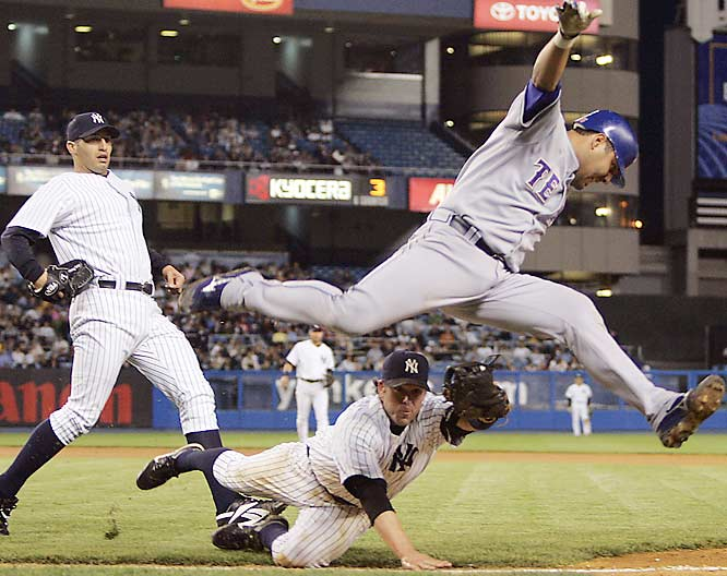 Gerald Laird leaps over the tag by Yankees' first baseman Doug Mientkiewicz after a bunt in the fifth inning on May 8.  Laird missed stepping on the base and Mientkiewicz then tagged the bag for the out.  The Yankees won 8-2.