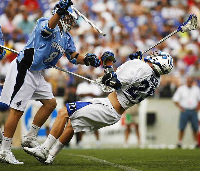 Duke attacker Zack Greer gets whacked by Johns Hopkins defenseman Ben O'Neill.