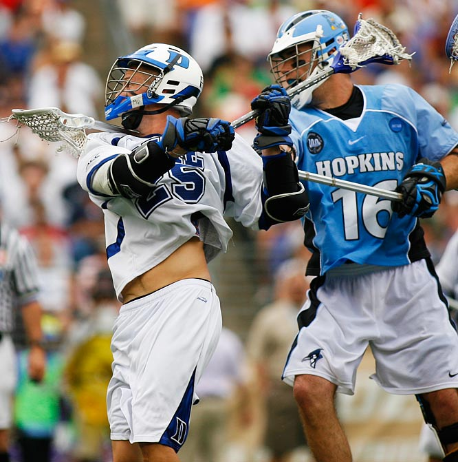 Duke attacker Mike Greer against Johns Hopkins defender Eric Zerrlaut.