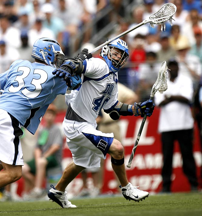 Duke attacker Matt Danowski in action against Johns Hopkins defenseman Michael Evans.