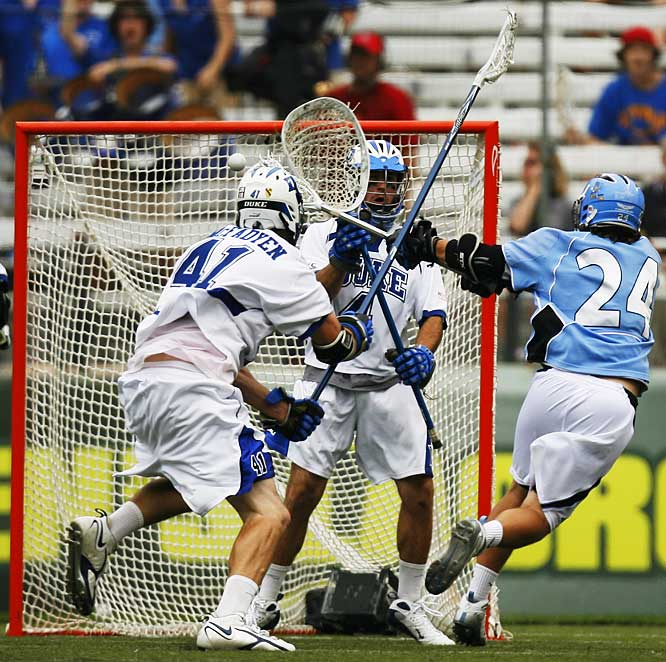 Kevin Huntley of Johns Hopkins University shoots what proves to be the game-winning goal past Duke University goalie Dan Loftus as Duke defenseman Ryan McFadyen arrives too late to prevent the shot.