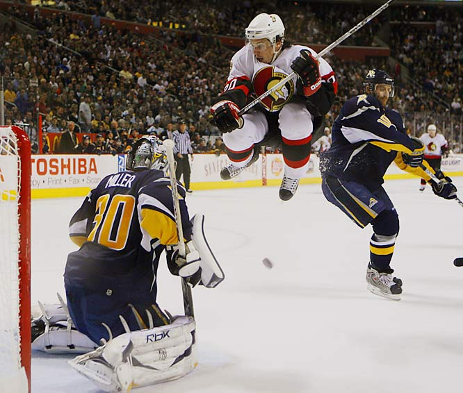 Antoine Vermette leaps out of the way of a shot on Sabres' goalie Ryan Miller in the third period.