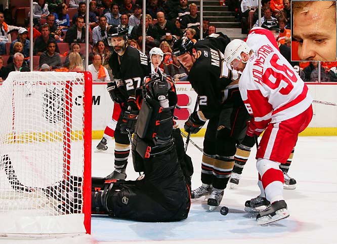 Tomas Holmstrom had two goals, an assist and 13 stitches as the Detroit Red Wings dominated the Ducks in their first game at Anaheim.  Holmstrom had two cuts on his forehead stitched up after the Ducks' Rob Niedermayer and Chris Pronger simultaneously slammed him into the glass midway through the second period.