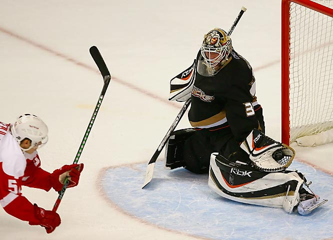 Ducks goalie Jean-Sebastien Giguere makes a glove save to rob Valtteri Filppula on a shorthanded breakaway attempt in the second period. With Anaheim defenseman Chris Pronger serving a one game suspension, Jiggy stepped up his game, stopping 36 of 39 shots by the Red Wings.
