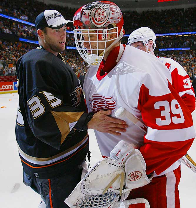 Red Wings goalie Dominik Hasek, 42, congratulates opposing netminder Jean-Sebastien Giguere, who turned 30 last week, on his play in the Anaheim Ducks series with Detroit.