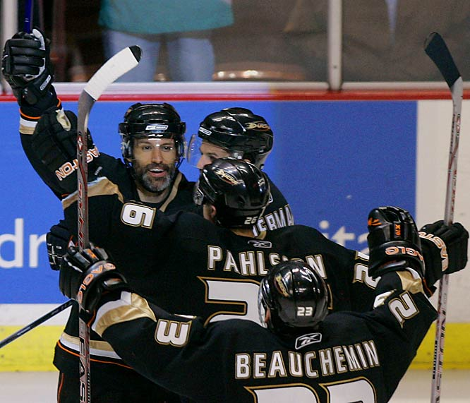 Defenseman Scott Niedermayer, left, celebrates his game-winning goal with his brother Rob as the Ducks closed out the best-of-seven series in five games. Rob had made a big hit to jar the puck loose and across to Scott, who nailed a wrist shot from the left point 4:30 into the second overtime.