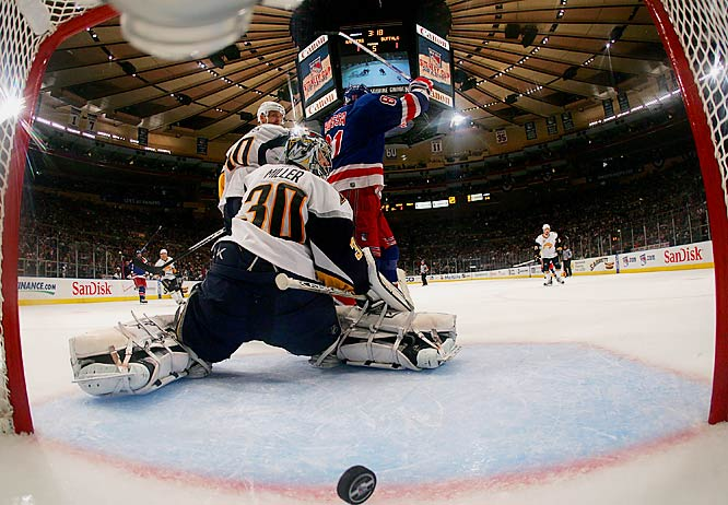 Rangers defenseman Michal Rozsival, not pictured, scores on a shot through traffic and off the post behind screened goalie Ryan Miller 16:43 into the second overtime. The win gave the Sabers a  2-1 series lead.