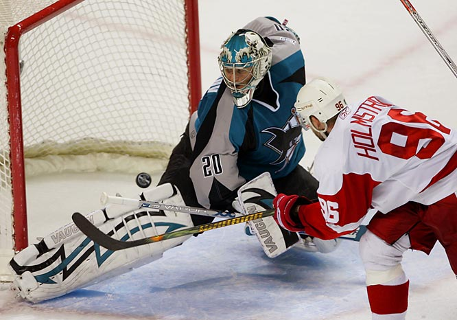 Tomas Holmstrom, playing in his first game since taking a stick to the eye April 22 in Detroit's series-winning victory over the Flames, scores a power-play goal in the final seconds of the second period. The goal started the Red Wings second comeback from a 2-0 deficit against the Sharks and helped them tie the series 2-2.