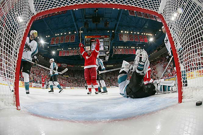 Tomas Holmstrom celebrates his power play goal in the third period against Sharks goalie Evgeni Nabokov.  The Red Wings converted on 2 of 6 power plays in the game to take a 3-2 lead in the series. The Sharks are 2-for-23 on the power play in the series.