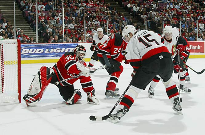 Ottawa's power trio of Dany Heatley, Daniel Alfredsson, left, and Jason Spezza, not pictured, combined for two goals and six points against Martin Brodeur and the Devils to close out the series 4-1 and advance the Sens to the Conference finals against Buffalo.