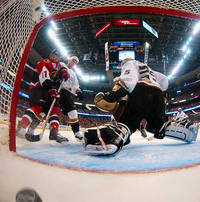 Senators' right wing Daniel Alfredsson scores as a shot from teammate Wade Redden hits Alfredsson's left skate. The power-play goal was immediately waved off, but the replay booth determined Alfredsson did not use a distinct kicking motion on the puck.