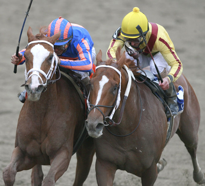 Rags to Riches made her move to the outside, while Curlin (right) had to wait to come off the rail.