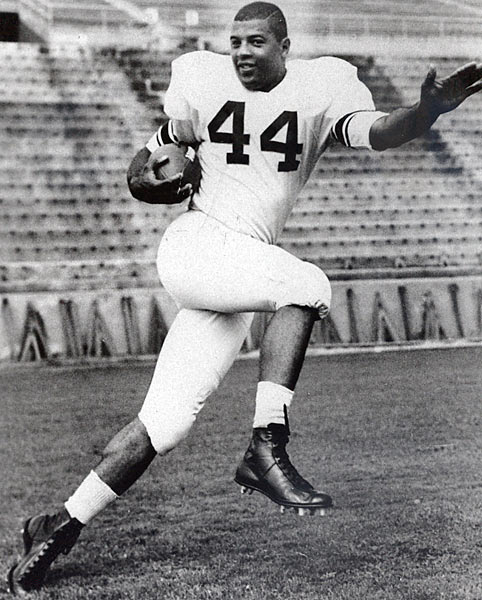 "His untimely death from Leukemia in 1963 prevented Davis from playing in the NFL, but his Syracuse career was illustrious. He helped lead the Orange to a National Championship in 1959 and two bowl victories, broke Jim Brown's SU career rushing record and helped build the legend of the number ""44"" at the school. In 1961 he became the first black player to win the Heisman Trophy."