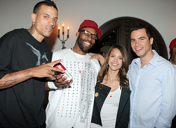 Golden State Warriors' Matt Barnes (left) and Baron Davis hang with a couple of their biggest fans, Jessica Alba and boyfriend Cash Warren.