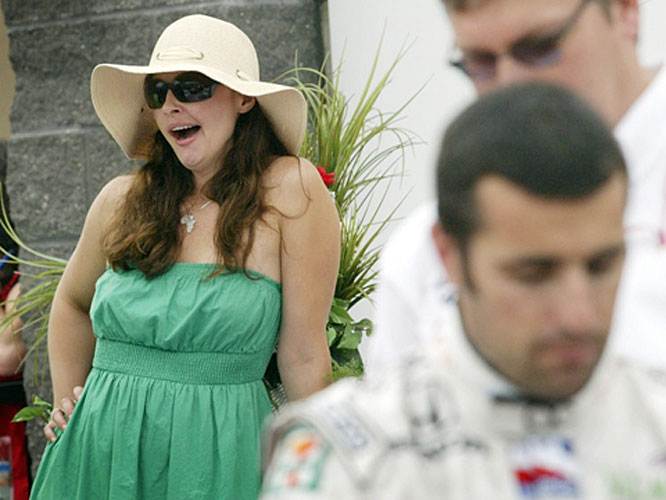 Actress Ashley Judd looks like she's getting tired of attending Indy car races.