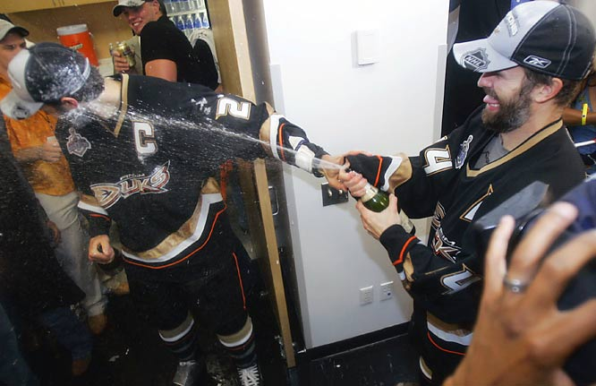 No matter age or profession, brothers will always annoy each other. Here, the Anaheim Ducks' Rob Niedermayer, right, sprays his brother Scott as they celebrate their Stanley Cup win.