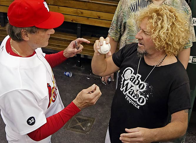 Cardinals manager Tony La Russa shows rocker Sammy Hagar how to throw 55.