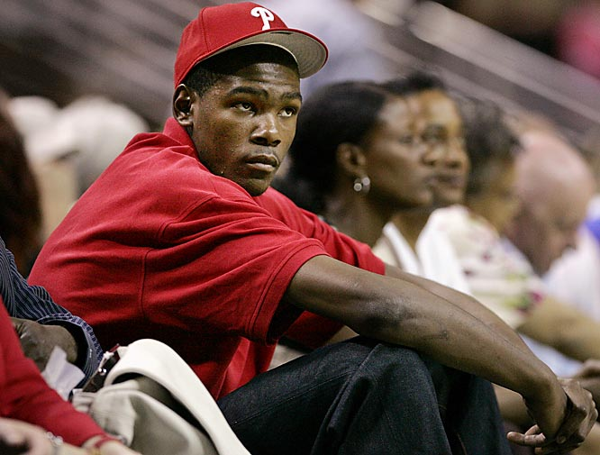 Kevin Durant looks riveted by the action at Wednesday's Seattle Storm-Detroit Shock WNBA game.