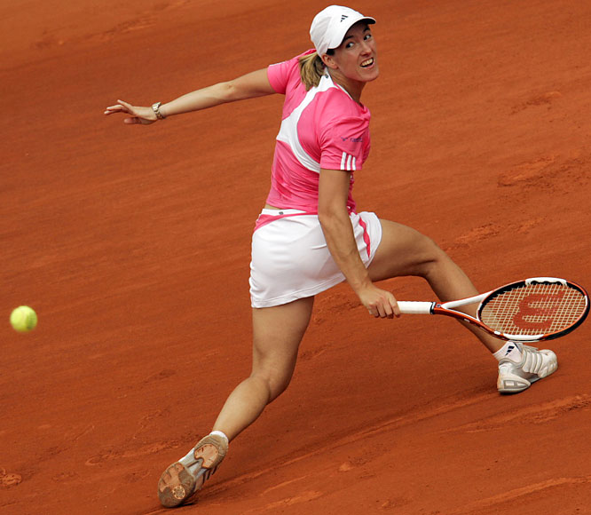 Justine Henin, the two-time defending champion, is two victories from becoming the first woman to win three consecutive French Open titles since Monica Seles (1990-92).