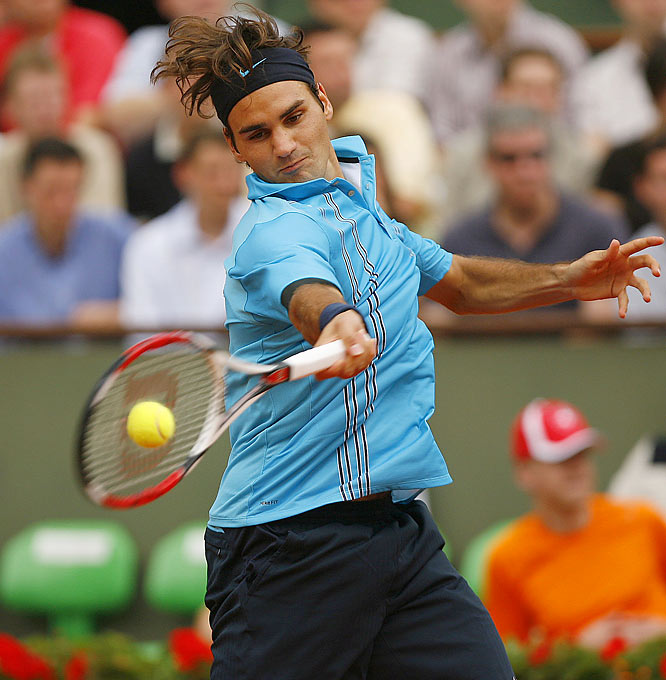 No. 1 Roger Federer overcame a second-set defeat and returned to dominant form, beating No. 9 Tommy Robredo in four sets, 7-5, 1-6, 6-1, 6-2.