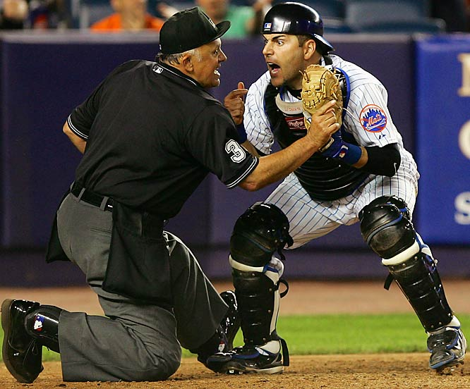 Mets catcher Paul Lo Duca argues with Randy Marsh after the Giants' Omar Vizquel beat Lo Duca's tag to score in the 12th inning May 29 at Shea Stadium. The Mets scored twice in the bottom of the inning to win 5-4.