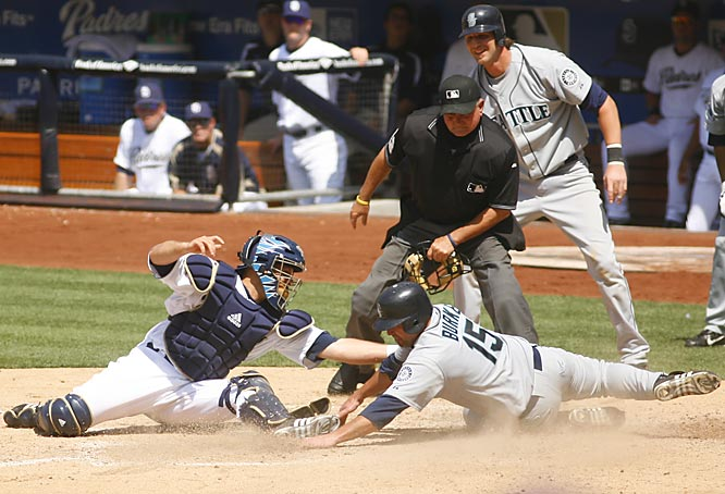 The Mariners' Jamie Burke beats the tag by Padres catcher Josh Bard at PETCO Park on Sunday.  Burke scored twice for Seattle in its 4-3 win, as the Mariners swept the three-game series.