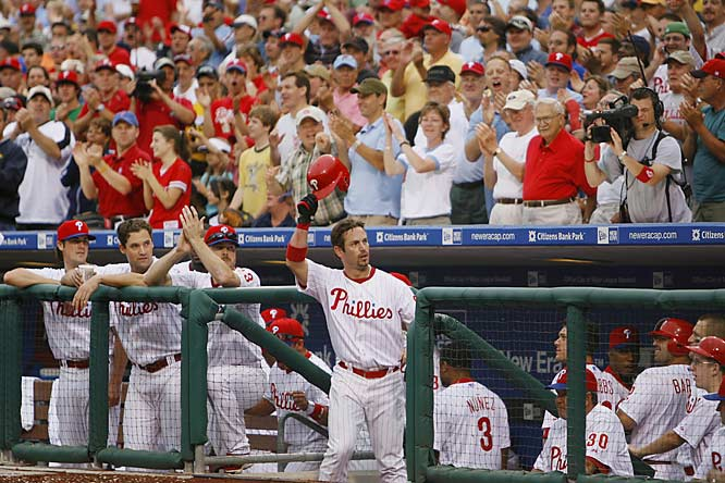 The Phillies' Aaron Rowand acknowledges the crowd after hitting a grand slam against his former team, the White Sox, in the seventh inning June 13 at Citizens Bank Park. Philadelphia won the game 8-4 to complete their first home sweep this season.