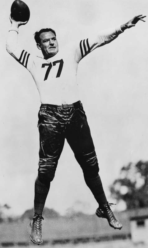 His is one of only two numbers retired by Illinois. Here's why: On October 28, 1924, Grange scored on runs of 95, 67, 56, and 45 yards -- in the first quarter. He scored a fifth touchdown in the third and passed for a sixth in the final quarter. As a pro with the Bears, his fame rivaled Jack Dempsey and Babe Ruth. <br><br>Runner-up: Ray Bourque.