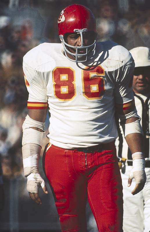 "The first player drafted by the AFL -- he went to the K.C. Chiefs in 1963 out of Grambling -- the fast, ferocious 6' 7"", 270-pound Hall of Fame defensive tackle swatted down 16 passes in 1967 and later played in two Super Bowls.<br><br>Runner-up: Hines Ward."