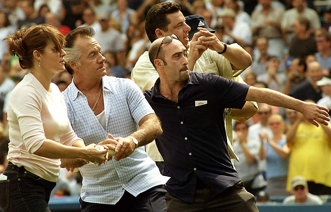 Prior to a White Sox-Yankees game in 2002, a number of cast members -- Lorraine Bracco (left), Tony Sirico (second from left), John Ventimiglia (center), Steve R. Schirripa (rear) and James Gandolfini (unseen)  -- promoted the show's season premiere, throwing out simultaneous first pitches. Later, Jamie-Lynn Sigler sang the national anthem.