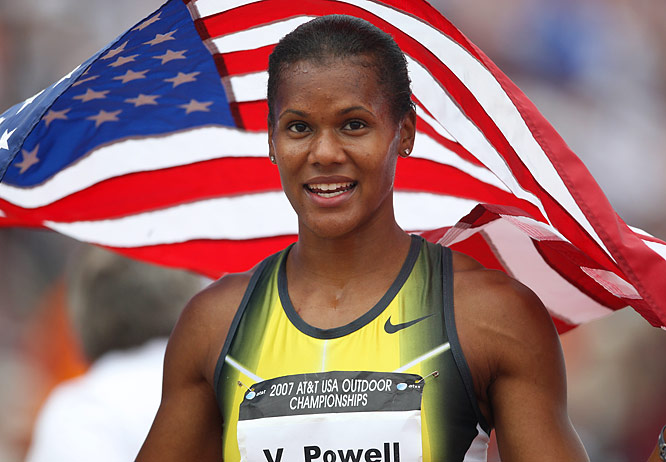 Virginia Powell shades herself with the American flag after winning the women's 100m hurdles in 12.63.