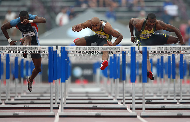 (Left to right) Linnie Yarbrough, Anwar Moore and David Oliver power over the 100m hurdles during heat 2. While Yarbough failed to qualify for the final, Oliver went on to finish third in the event.