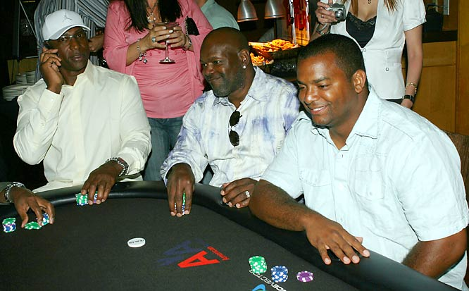 Which one of these things doesn't belong? Hall of Fame running backs Eric Dickerson and Emmitt Smith are at the poker table with Alfonso Riberio.