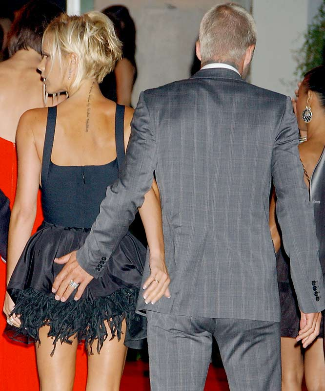 """David Beckham cops a feel while entering the """"Beckham Welcome To LA Party"""" at the Museum of Contemporary Art last weekend."""