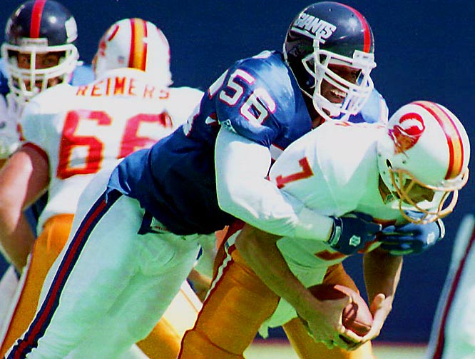 1981-1993 N.Y. Giants <br><br>Taylor transformed the position of outside linebacker from read-and-react to attack mode. His aggressiveness, intensity, speed and strength made him a dominant defensive player and one of the most feared players in football.