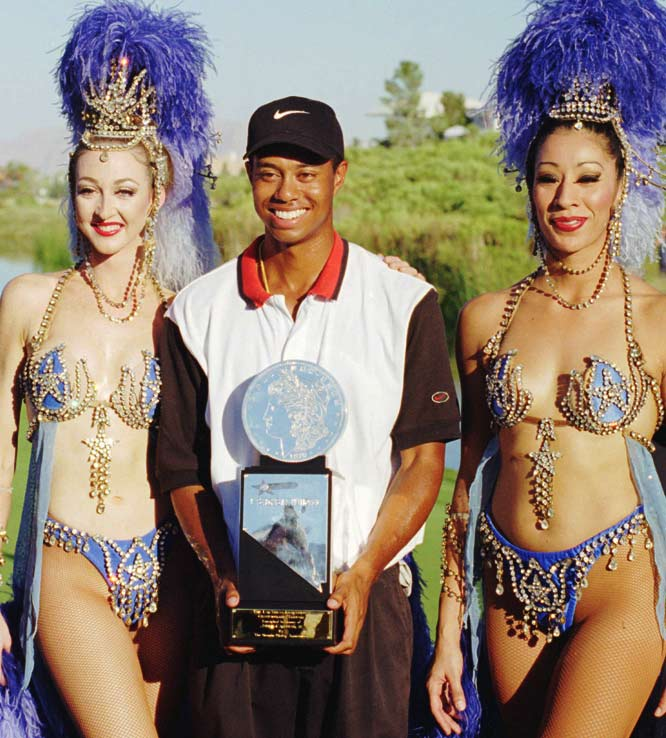 Tiger Woods turned pro in 1996 and won his first professional victory at the Las Vegas Invitational. Later that year he was named SI's Sportsman of the Year.