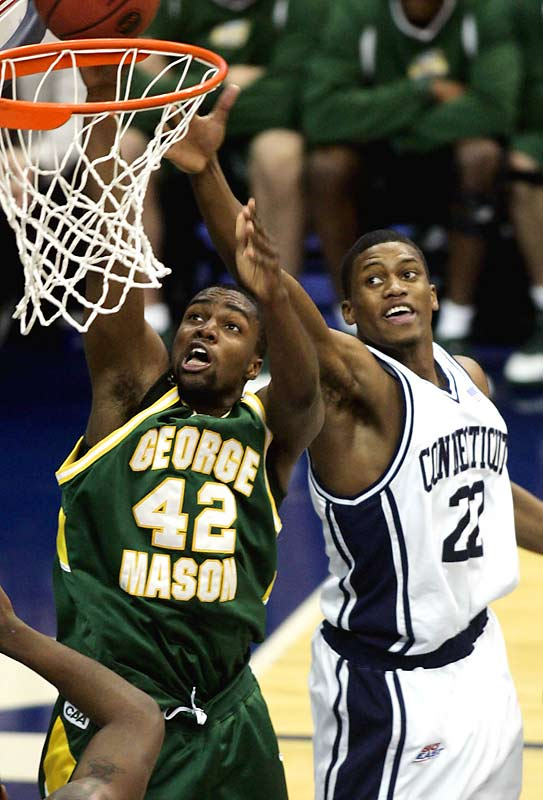 George Mason's Folarin Campbell soared over UConn's Rudy Gay in one of the biggest upsets in NCAA tourney history.