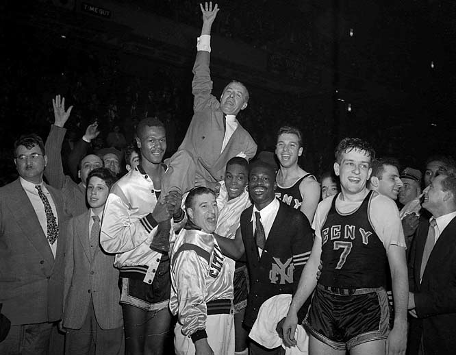After five Brooklyn College players admitted to accepting bribes to ensure a loss to Akron in 1945, point-shaving was initially regarded as an isolated incident. By 1951, it had spread to CCNY, upset winner of the 1950 NCAA title, and to Kentucky, the country's most storied program. By the mid-1950s, the Manhattan D.A. had implicated 32 players from seven schools who had accepted payoffs from gamblers to make sure their teams did not cover the point spread. Investigators discovered 86 games that had been fixed from 1947-50.