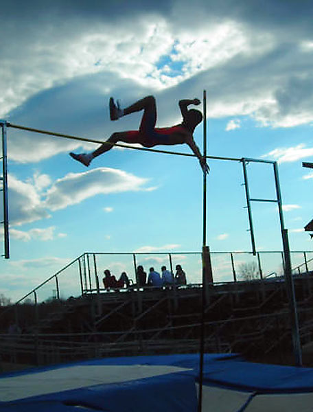 A Broomfield High (Connecticut) pole vaulter clears 11-6.