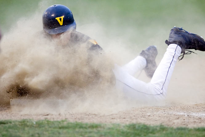SI and Takkle.com teamed up to find some of the best high school amateur photos, and what follows is the winner and six finalists.<br><br>A Saint John Vianney High (St. Louis) player safely slides back to first in a game against St. Louis University High this spring.